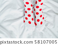 Women's legs in socks colors alternating. 58107005