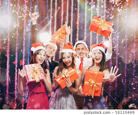 happy young group having fun in christmas party 58110469
