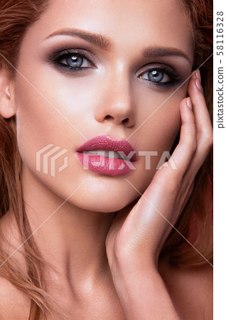 Make up. Glamour portrait of beautiful woman model with fresh makeup and romantic wavy hairstyle. 58116328