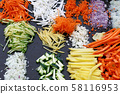 Assorted cut sliced vegetables on cooking board 58116953