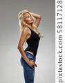 beautiful blonde woman in a black T-shirt and jeans 58117128