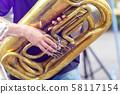 A tuba musician closeup in the city street 58117154