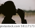 silhouette of woman waiting for flight aircraft. 58117173