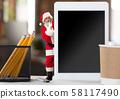 Happy Christmas Santa Claus whispering a secret 58117490