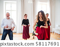 Group of senior people in dancing class with dance teacher. 58117691