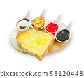 Toast with butter and topping. 58120448