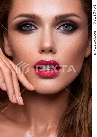 Portrait of beautiful girl with pink lips 58120701
