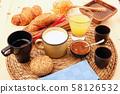 breakfast on rustic wooden table 58126532