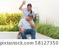 The wife was pushing the wheelchair for her 58127350
