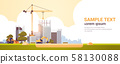modern construction site with cranes tractor and bulldozer unfinished building exterior sunset 58130088
