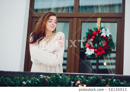 Girls standing on a balcony 58130913