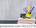 School supplies mockup on blackboard background 58131578