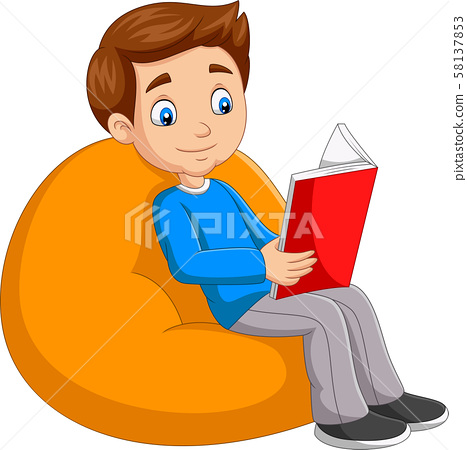 Young boy reading a book sitting on big pillow 58137853