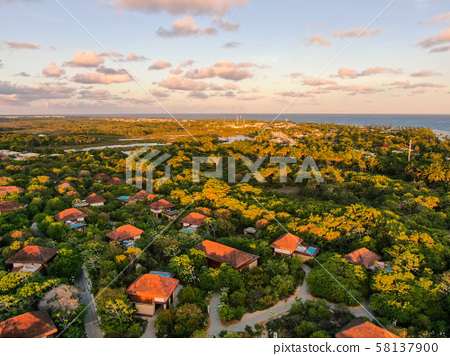 Beach, ocean and tropical forest during sunset 58137900
