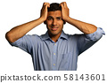 Stressed young businessman holding his head 58143601