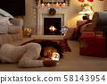 Girl at home at Christmas time 58143954