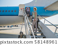 Passengers boarding the aircraft at the international airport. Airplane ready for departure Travel 58148961