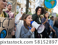 Small child with amplifier on global strike for climate change. 58152897