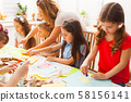 Children attend class on how to make postcards 58156141