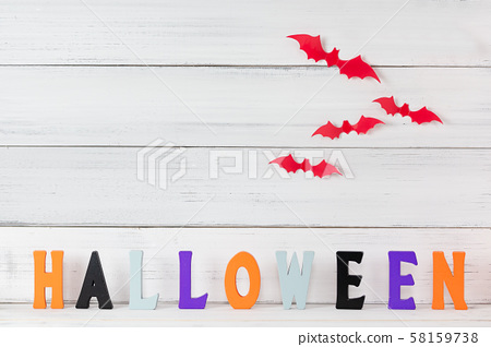 Halloween letters  and red bats flying over white 58159738