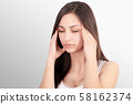 Woman In Pain. Closeup Of Beautiful Young Female Feeling Painful Toothache, Touching Face With Hand 58162374