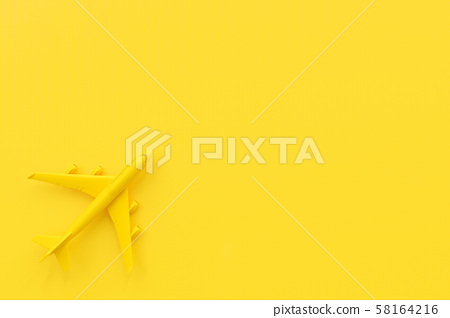 Airplane on yellow background. 58164216