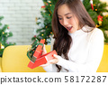 beautiful girl open christmas present gift box 58172287