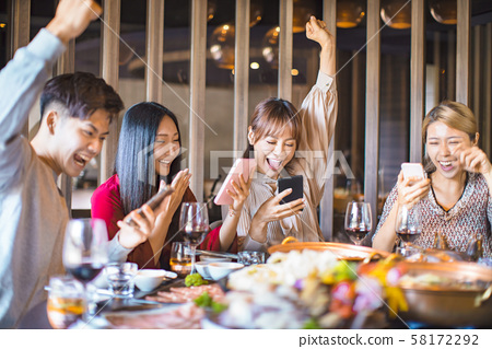 Group of friends having fun at the restaurant and 58172292