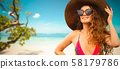 Happy young woman at beach in summer vacation. 58179786