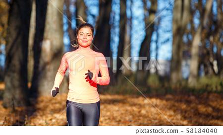 Fitness girl training running in the morning park 58184040