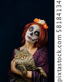 A young woman in day of the dead mask skull face art. 58184134