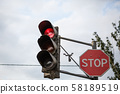 traffic light the three colors, with red stop sign 58189519