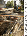 repair of a pipe, an excavator on the road  58190181