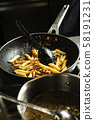 penne rigate in a frypan in a professional kitchen 58191231
