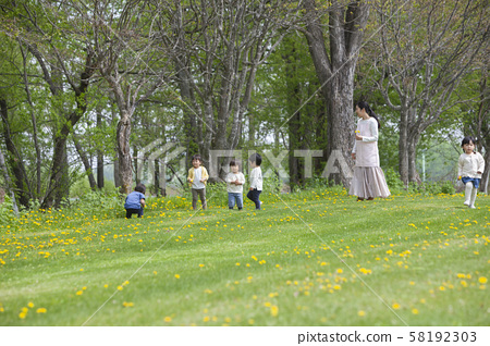 Children playing with nursery teachers 58192303
