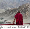 A monk at ancient Tibetan temple 58194235