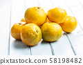 Fresh yellow tangerines. 58198482