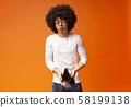 Unhappy black millennial guy showing empty wallet 58199138