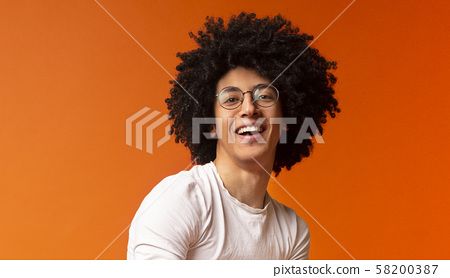 Portrait of awesome stylish african guy with bushy hairstyle 58200387