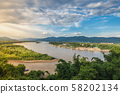 Golden triangle between three countries: Thailand, Myanmar, and Laos with two rivers meeting.  58202134