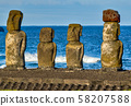 Moai on Easter Island with red topknot hats at Anakena Ahu 58207588