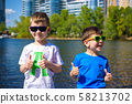 Portrait of happy kids on a bright sunny day. 58213702
