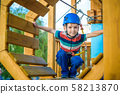 Happy boy having fun and playing at adventure 58213870