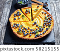 close-up of pumpkin pie decorated with blueberries 58215155