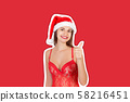 sexy tanned girl in red swimsuit and christmas hat 58216451