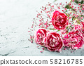 Bouquet of pink carnation on light turquoise wooden background 58216785