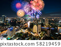 Beautiful fireworks celebrating new year along 58219459