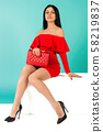 Beautiful legs woman wearing red dress with purse 58219837
