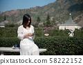 portrait woman holding smart phone. 58222152
