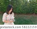 portrait woman holding smart phone. 58222159
